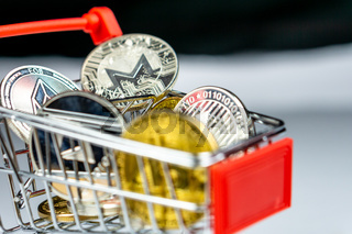 Bitcoin coins and altcoins in a shopping cart