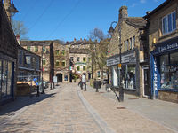 bridge gate in the centre of hebden bridge with shops and cafes on either side of the road