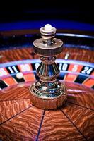 Roulette wheel in casino, gambling ad