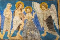 Jesus is baptized in the Jordan by John the Baptist