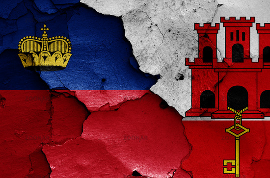 flags of Liechtenstein and Gibraltar painted on cracked wall