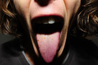 guy with open mouth showing his tongue