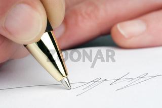 Unterschrift mit Kugelschreiber