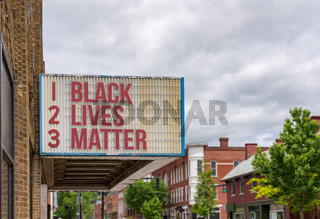 Mockup of movie cinema billboard with Black Lives Matter on the message board