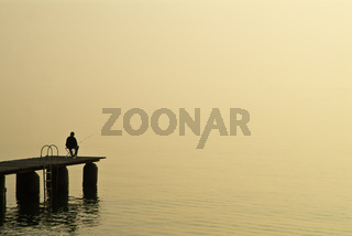 Angler am Morgen am Gardasee