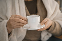 Female Hands Holding A White Cup With Hot Tea