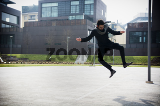 Handsome young man jumping for joy