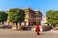 Mubarak Mahal City Palace and an Indian woman, Jaipur, India