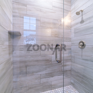 Square frame Large modern tiled shower cubicle bright interior