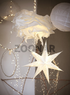 Abstract paper decorations with fairy lights