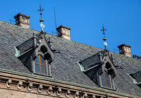 Dormer windows on the roof of gothic building