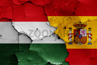 flags of Hungary and Spain painted on cracked wall