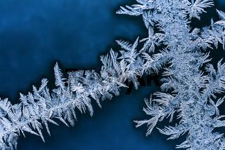 Frosty patterns on winter window glass macro