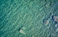 Aerial view on underwater reefs in mediterranean sea with clear transparent water. Crete, Greece