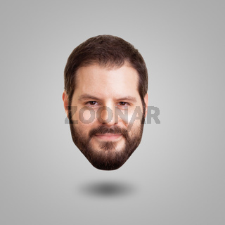Levitating head of a bearded smiling man isolated on grey background. Creativity