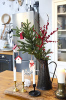Christmas composition on kitchen table at home
