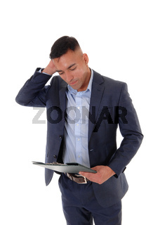 Puzzled man is looking at his clipboard
