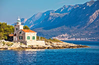Lighthouse of Sucuraj on Hvar island and Biokovo mountain background view