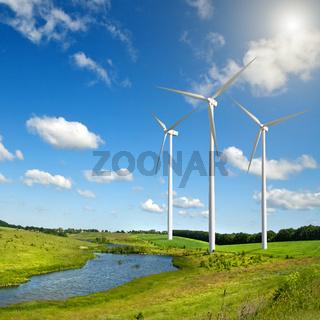 Wind generators turbines on summer landscape