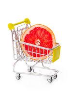 Ripe grapefruit in shopping cart