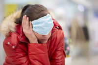 The woman put on a medical mask over her eyes and lay down to rest. Fatigue from the coronavirus epidemic.
