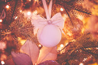 Closeup of Christmas tree decorations. Selective focus with retro faded colors