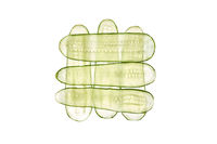 Square pattern from thin transparent slices of natural organic cucumber.