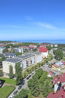 Panorama of Wladyslawowo town from above with streets houses cars and sea