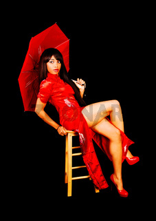 lovely woman in red Chinese dress with umbrella