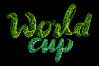 World cup the inscription is made of green sparkling confetti