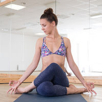 Fit sporty active girl in fashion sportswear doing yoga fitness exercise in yoga studio. Active urban lifestyle.
