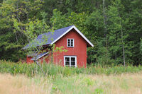 Red shed and forest in Dalsland; Sweden.