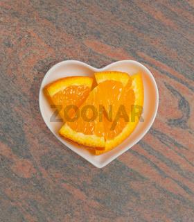 Apfelsine in einer weißen Schale für die Food Fotografie