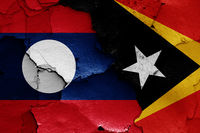 flags of Laos and East Timor painted on cracked wall