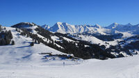 Snow covered mountain ranges seen from Horeflue, Schoenried.