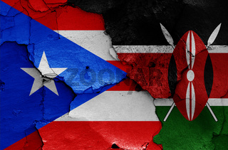 flags of Puerto Rico and Kenya painted on cracked wall