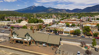 Flagstaff, Arizona/USA- August 28, 2019: Traffic makes it's way past the train station along route 66 in Flagstaff, Arizona USA 2019
