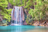 Waterfall and emerald lake in tropical forest, Erawan, Thailand