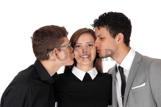 Sister gets a kiss from her two brothers