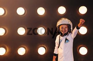 Happy confident kid in uniform pretending to be astronaut