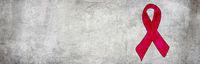 stein wand symbol gedenken schleife