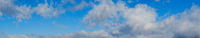 Blue sky with clouds, wide cloudscape background panorama