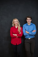 Business couple on chalkboard background