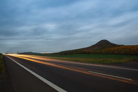 Light trails on the road in Central Bohemian Highlands, Czech Republic.