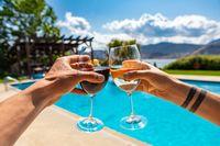 wine drinking tasting on swimming pool