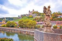 Wurzburg. Main river waterfront and scenic Wurzburg castle and vineyards reflection view