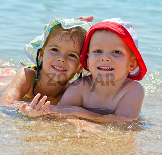 Cute young kids at the sea;