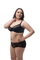 Fat brunette in black lingerie isolated view