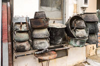 Several old cauldrons in heap
