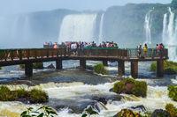 Tourists watch the waterfalls of Iguazu